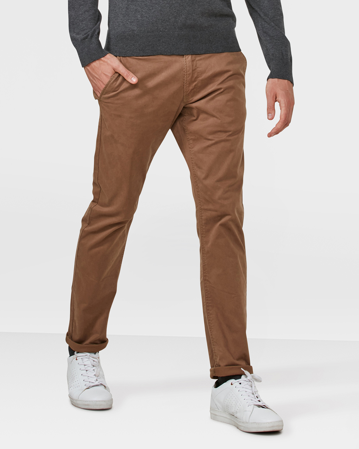 These chinos (aka khakis) are cut in our slim fit and made of the same fabric we use for our other chinos, just with a small bit of added flex.